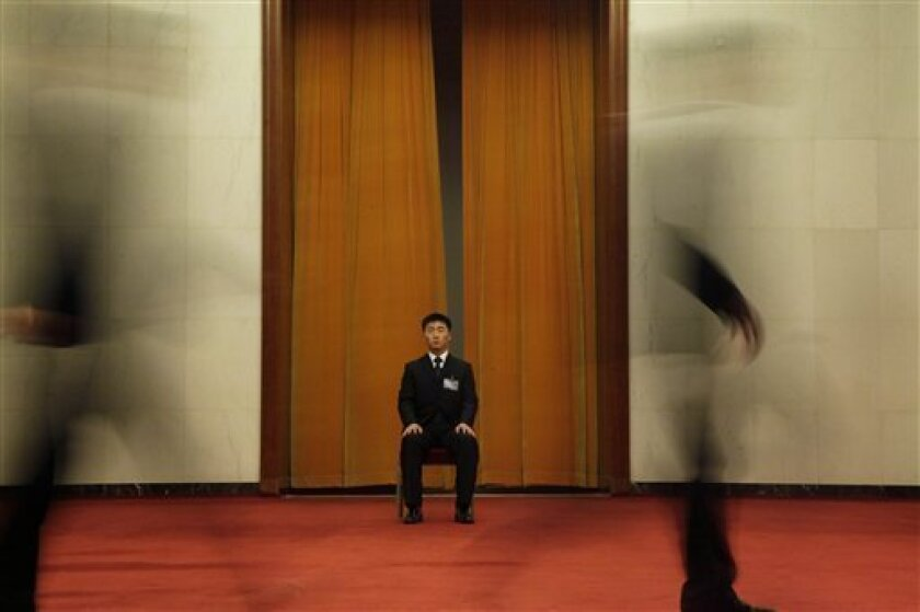 A security guard is on duty in the Great Hall of the People in Beijing, China, Sunday, March 7, 2010. China's annual parliament meeting is ongoing in the Chinese capital. (AP Photo/Ng Han Guan)