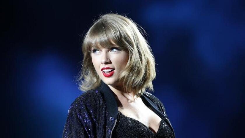 Taylor Swift, shown in 2015 at her Petco Park concert in San Diego, has topped Forbes' 2016 list of the top-earning women in music.