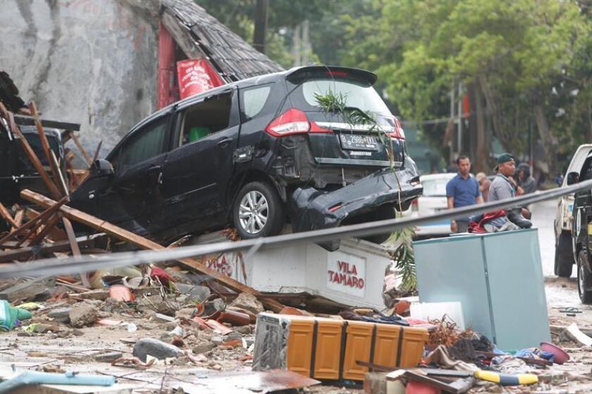 A damaged car is seen among the debris after a tsunami hit the Sunda Strait in Pandeglang, Banten, Indonesia, 23 December 2018. EFE/EPA/ADI WEDA