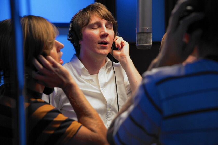 "Paul Dano, center, as Brian Wilson in ""Love & Mercy."""