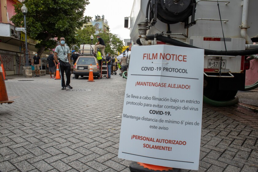 """A COVID-19 warning sign on the set of """"Simone,"""" filmed in San Juan, Puerto Rico."""