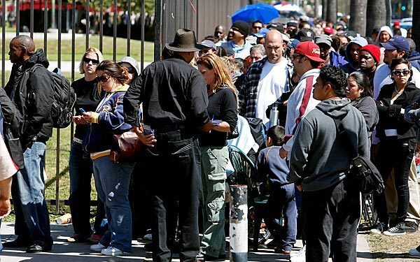 Thousands of people line the perimeter of the L.A. Sports Arena hoping to get wristbands for access to free medical care from Remote Area Medical's seven-day clinic. Only 1,200 wristbands were handed out Wednesday, leaving many disappointed and frustrated.