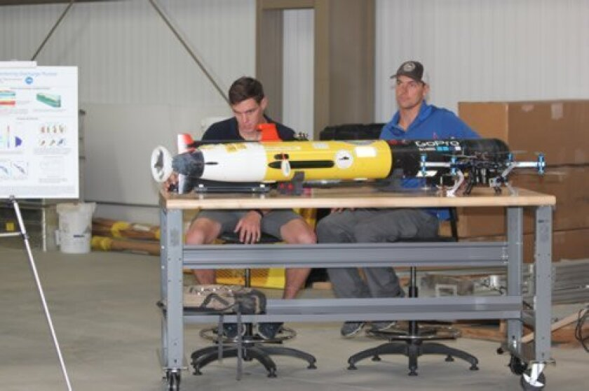 Scripps Institution of oceanography researchers at work in the new Seaweed Canyon facility.