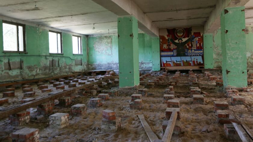 The deserted barracks of he Soviet S75-4M ant-aircraft missile system base abandoned in the woods 3