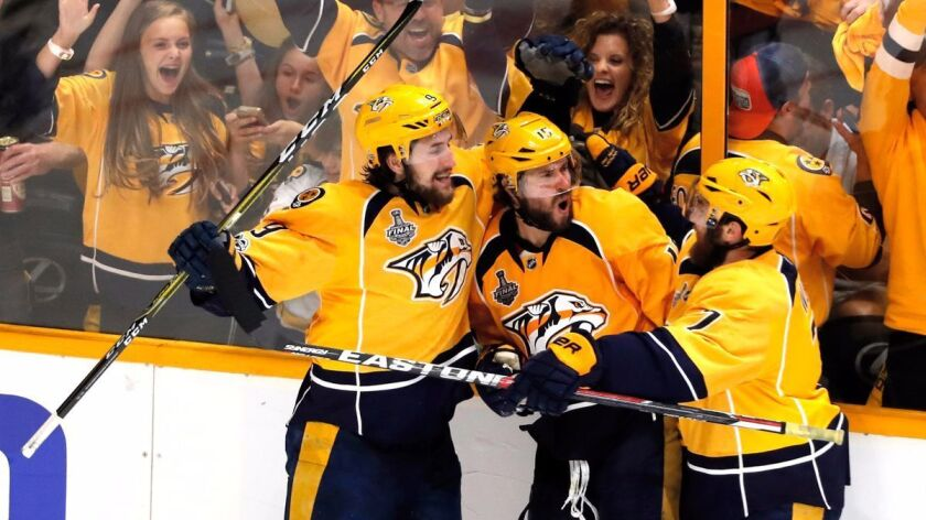 NASHVILLE, TN - JUNE 03: Craig Smith #15 of the Nashville Predators celebrates with teammates after