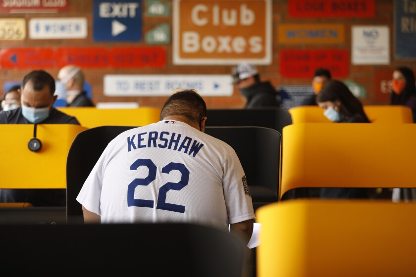 Adam Tapia, 23, wearing his Kershaw jersey, came from Whittier to vote Tuesday at Dodger Stadium in Elysian Park.