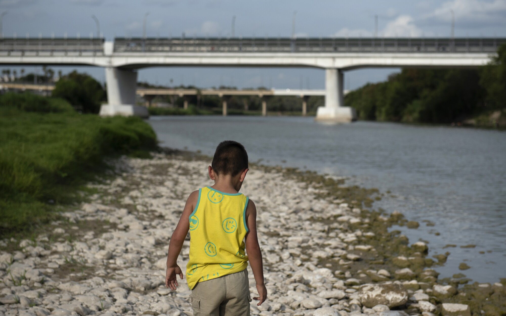 A child walks along the bank of the Rio Grande in Laredo, Texas.