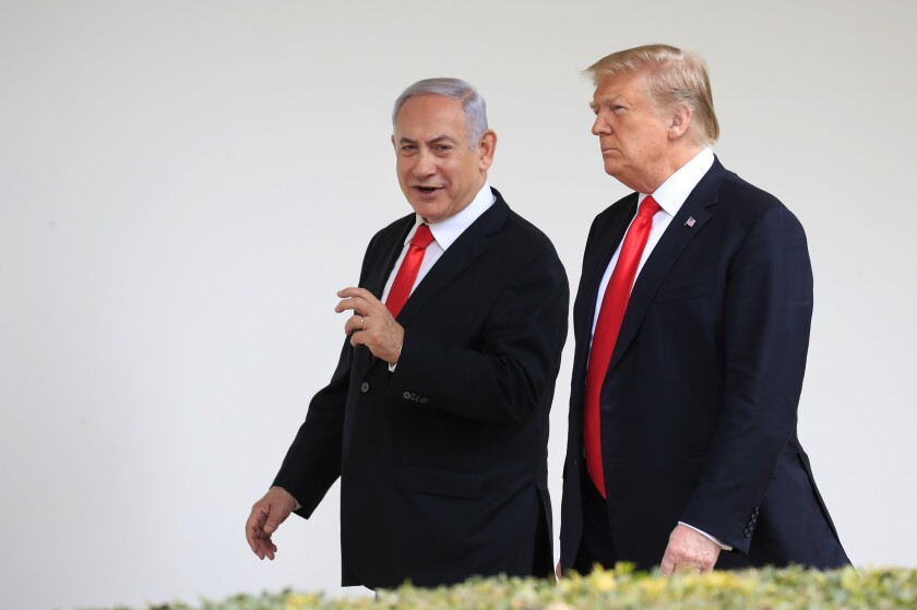 FILE - In this March 25, 2019, file photo, President Donald Trump and visiting Israeli Prime Minister Benjamin Netanyahu walk along the Colonnade of the White House in Washington. For the past three years, Netanyahu has bet heavily on Trump and been rewarded with major diplomatic gains in exchange for his warm embrace of the U.S. leader. But the U.S. pullback from northeastern Syria, essentially abandoning its Kurdish allies, has called that strategy, and Trump's reliability as a friend, into question. (AP Photo/Manuel Balce Ceneta, File)