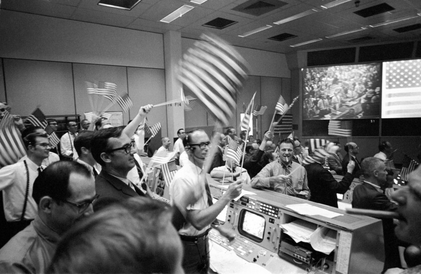 July 24, 1969: Flight controllers at Mission Control in Houston celebrate the successful conclusion of the Apollo 11 lunar landing mission.