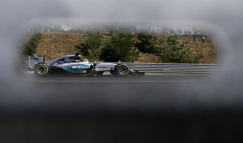 Mercedes driver Lewis Hamilton of Britain steers his car during the Hungarian Formula One Grand Prix in Budapest, Hungary, Sunday, July 26, 2015. (AP Photo/Darko Vojinovic)