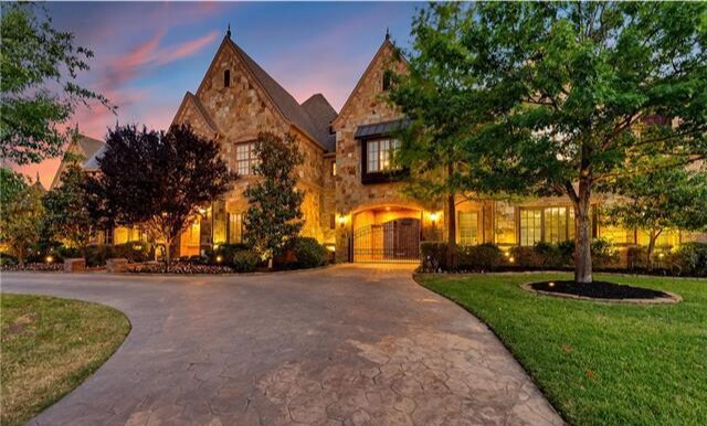In over 9,000 square feet, the two-story home holds six bedrooms, seven bathrooms and eight fireplaces.