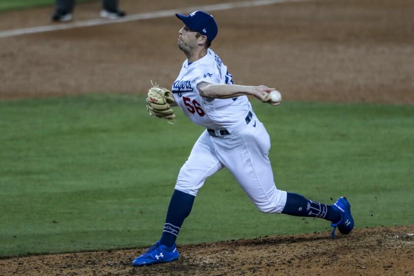 Dodgers relief pitcher Adam Kolarek delivers during the sixth inning.