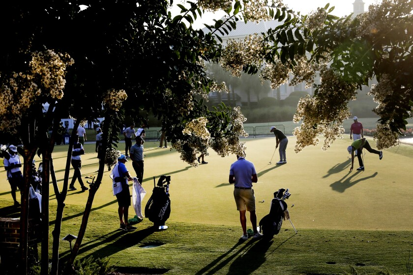 Golfers warms up on the practice green, during the second round of the RBC Heritage golf tournament, Friday, June 19, 2020, in Hilton Head Island, S.C. (AP Photo/Gerry Broome)