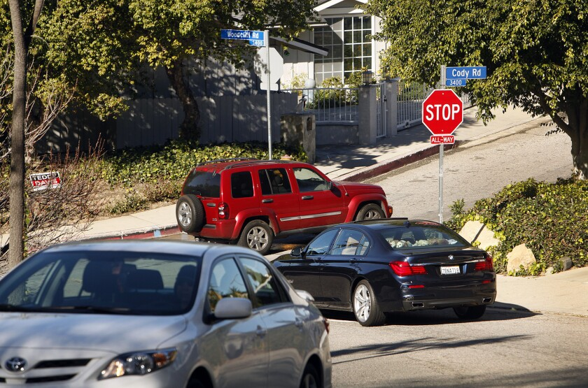 Vehicles crowd the intersection of Cody Road and Woodcliff Road in Sherman Oaks on Jan. 5, 2015. Residents say the worsening traffic on side streets is partially a result of the rise of navigation apps like Waze and Google Maps.