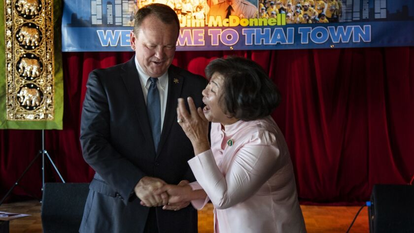 Los Angeles County Sheriff Jim McDonnell greets a Thai Town resident during a campaign stop at Thailand Plaza in Los Angeles.