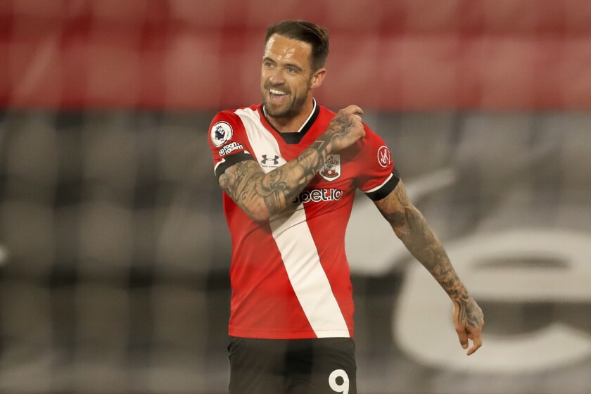 Southampton's Danny Ings celebrates after scoring his side's third goal during an English Premier League soccer match between Southampton and Crystal Palace at St Mary's Stadium in Southampton, England, Tuesday May 11, 2021. (Andrew Boyers/Pool via AP)