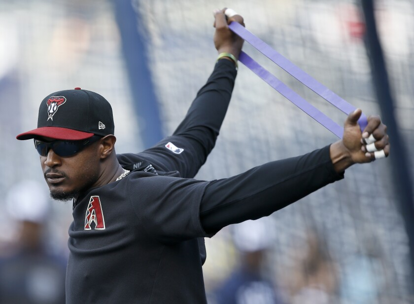 The Diamondbacks' Adam Jones warms up during batting practice before Monday's game against the Padres.