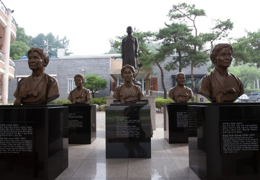 """Bronze busts of """"comfort women,"""" who spent World War II in Japanese military brothels, cover a portion of the courtyard at """"The House of Sharing"""" in Seoul. Details about each woman and her plight are engraved in marble."""