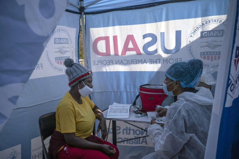 A nurse talks to an HIV-positive patient at a mobile clinic in South Africa.
