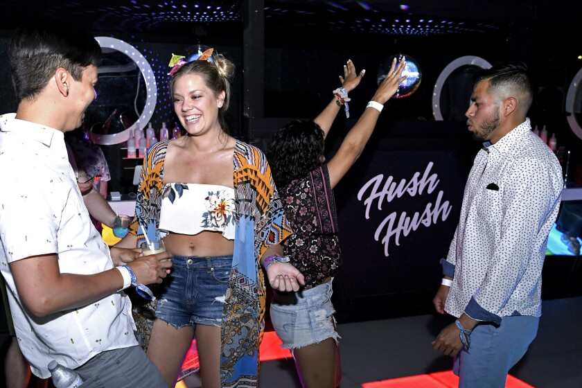 INDIO, CA-April 13, 2019: Partygoers dance the day away for photos inside Hush Hush at the Coachell