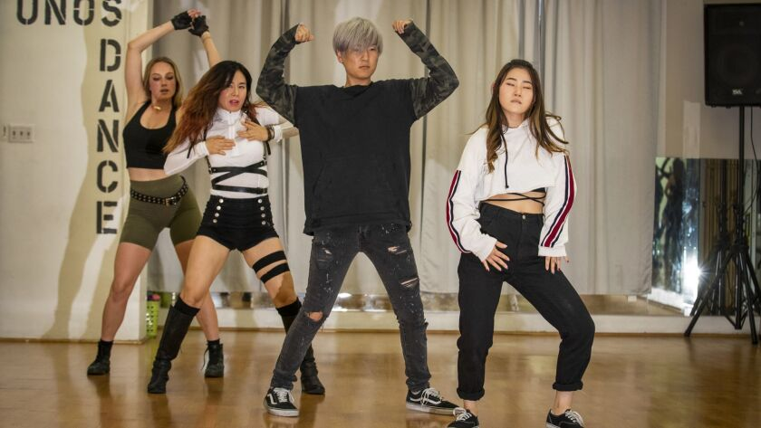 From left: Helen Molinski, Uno Lee, Clifford Ki, Yegin Kim practice their moves during a K-Pop dance class that happens twice a week at Uno's Dance Fitness Center near Koreatown.