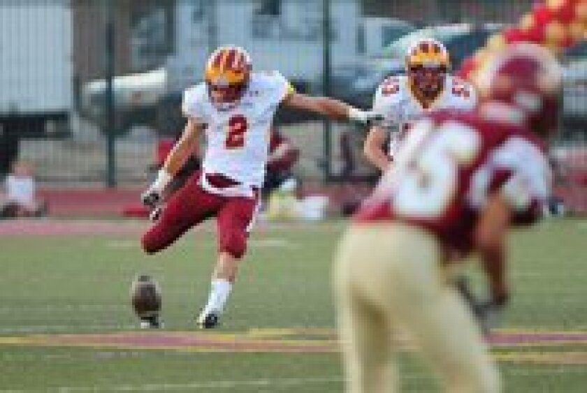 """Torrey Pines Senior Kicker Jack Mitchell has been invited to bring his kick-off skills to the Big 10's Northwestern University, where he will be a """"preferred walk-on"""" in the Fall.  Mitchell (No 2), shown here kicking off September 2, 2011 v. Colton High School, routinely put his kick-offs into the"""