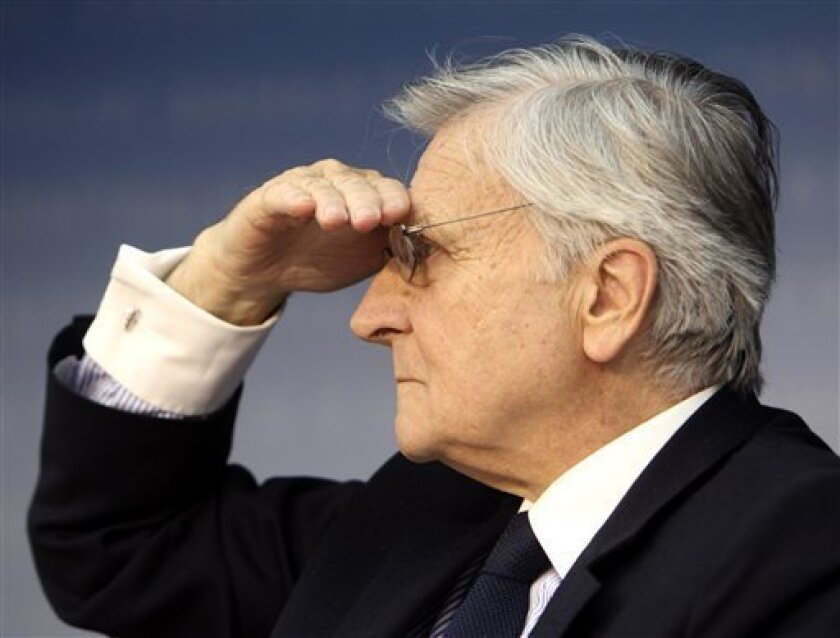 """President of European Central Bank, Jean-Claude Trichet, gestures during a press conference in Frankfurt, Germany, on Thursday, June 9, 2011. The head of the European Central Bank is signaling a likely interest rate hike in July. Jean-Claude Trichet said the bank was exercising """"strong vigilance"""" against inflation - regarded as code for an increase at the next month's meeting. His comments Thursday came after the bank left its key rate unchanged at 1.25 percent. (AP Photo/Michael Probst)"""