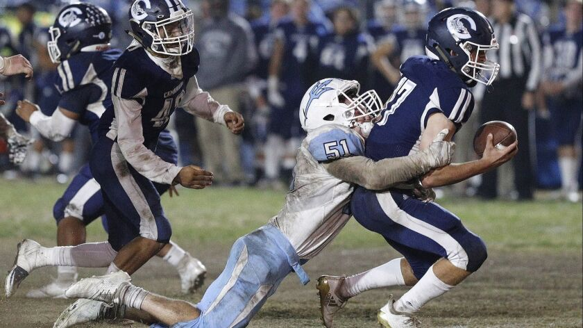 Corona Del Mar's Tristen Troutman sacks Camarillo quarterback James McNamara for a loss near the end