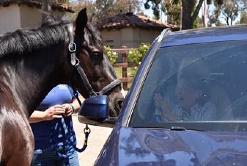 Jack greets clients from Alzheimer's San Diego.