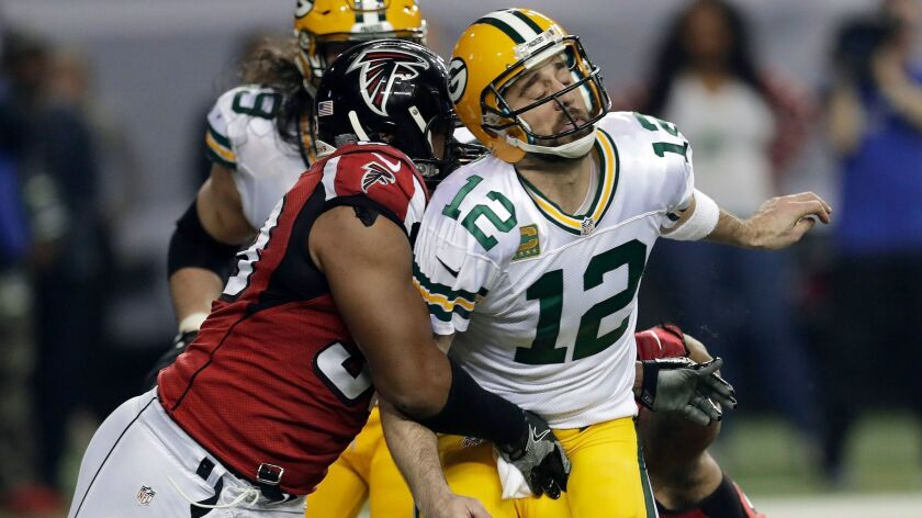 Atlanta Falcons defensive end Dwight Freeney hits Green Bay Packers' quarterback Aaron Rodgers during the NFC championship game on Jan. 22.