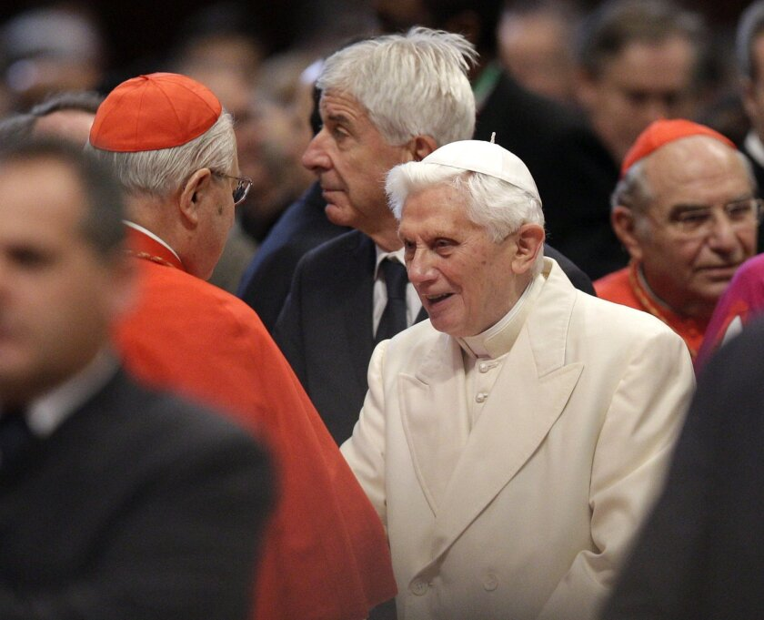 Pope Emeritus Benedict XVI is greeted by Cardinal Angelo Sodano, left, as he arrives for a consistory inside the St. Peter's Basilica at the Vatican, Saturday, Feb.22, 2014. Benedict XVI has joined Pope Francis in a ceremony creating the cardinals who will elect their successor in an unprecedented blending of papacies past, present and future. (AP Photo/Alessandra Tarantino)