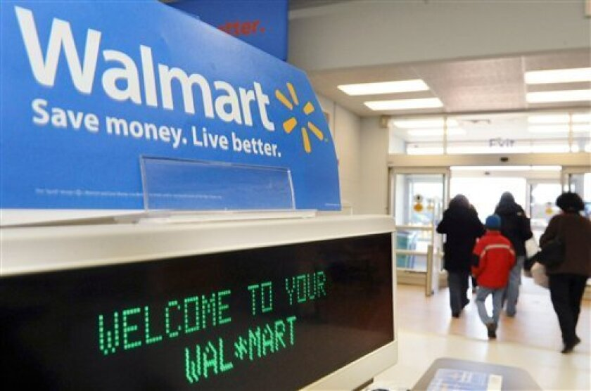 Wal-Mart lowers forecasts