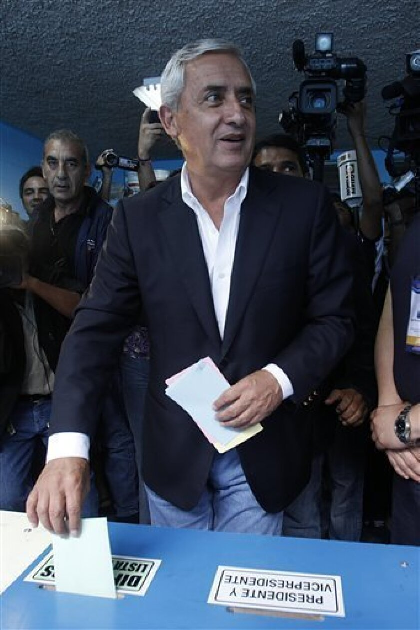 Guatemala's presidential candidate of the Patriotic Party Otto Perez Molina casts his vote at a polling station during the country's presidential elections in Guatemala City, Sunday, Sept. 11, 2011. (AP Photo/Moises Castillo)