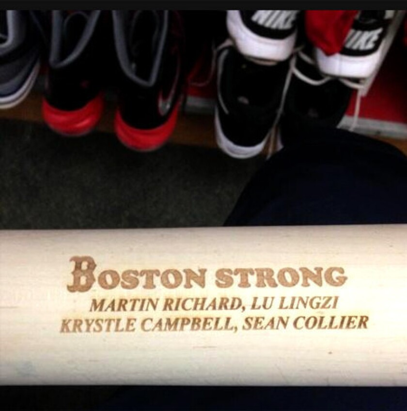 Jonny Gomes honors Boston Marathon victims with names on his bat