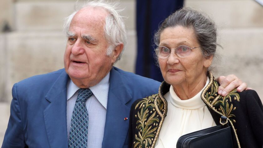 Simone Veil leaves the Institut de France with her husband, Antoine Veil, after her entry ceremony a