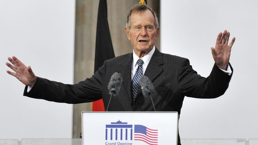 Former President George H.W. Bush speaks at a ceremony to open the new U.S. Embassy in Berlin on July 4, 2008.