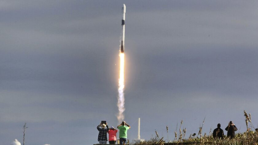 SpaceX fans watch the Falcon 9 lift-off from pad 39-A in this view from Playalinda Beach, Fla., just