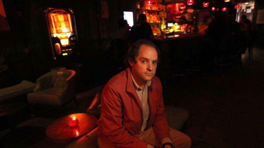 """Aaron Katz, writer/director of the L.A.-set crime drama """"Gemini,"""" is photographed inside the Tonga Hut in North Hollywood on March 22."""