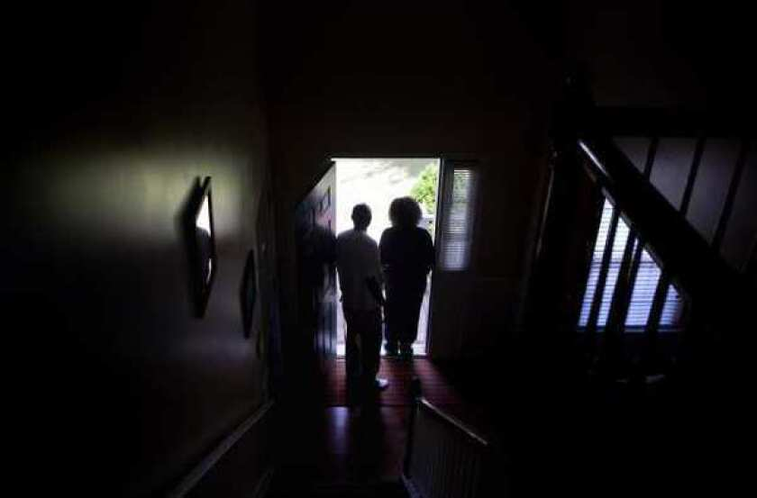 Michael and Patricia Jackson stand in the doorway of their home in Marietta, Ga.