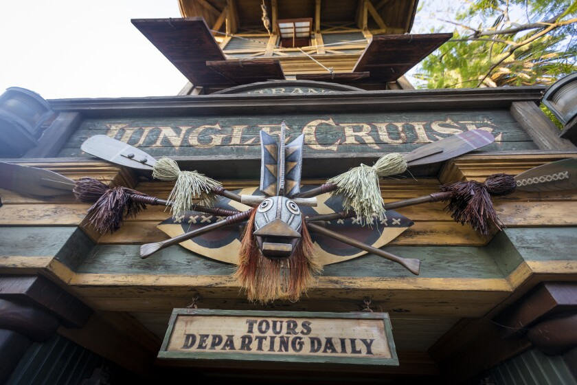 """A sign reads """"Jungle Cruise - Tours Departing Daily"""""""