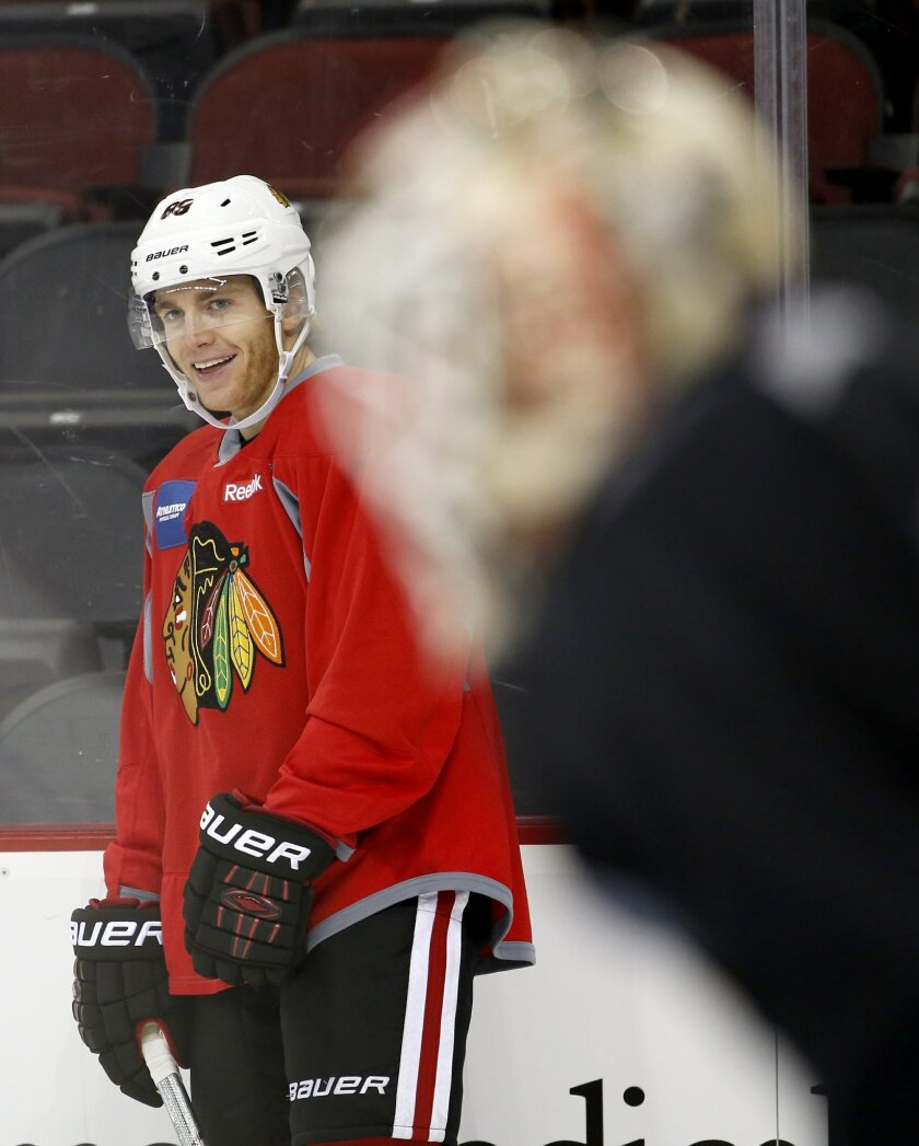 Chicago Blackhawks' Patrick Kane, left, works out during a morning skate prior to facing the New Jersey Devils, Friday, Nov. 6, 2015, in Newark, N.J. Prosecutors announced Thursday, Nov. 5, 2015, that they will not bring rape charges against Kane, citing a lack of credible evidence and the accuser'