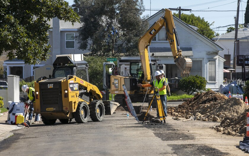 Crews install new sewer pipes on Golden Gate Drive in University Heights last year.