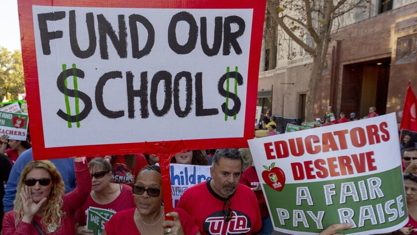FILE - In this Dec. 15, 2018, file photo, thousands of teachers marched and rallied in downtown Los