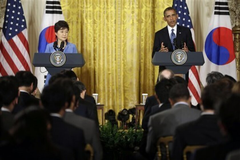 President Barack Obama and South Korea President Park Geun-Hye answer questions during a news conference in the East Room of the White House in Washington, Tuesday, May 7, 2013. (AP Photo/Pablo Martinez Monsivais)