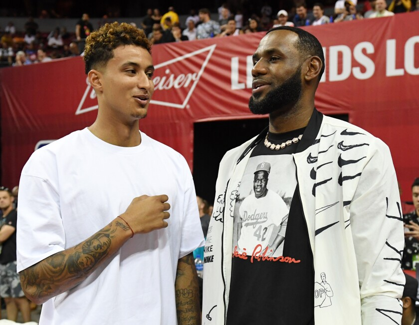 Kyle Kuzma chats with Lakers teammate LeBron James during the Las Vegas Summer League.