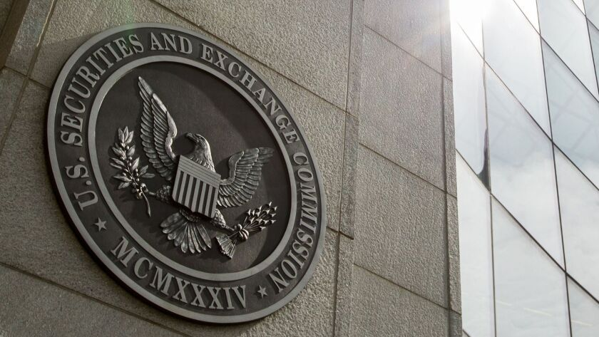 The seal of the U.S. Securities and Exchange Commission at SEC headquarters in Washington is shown. The agency has alleged Craig Arsenault, a Laguna Niguel money manager, committed civil securities fraud.