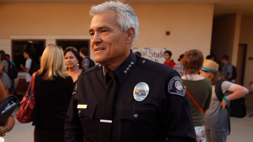 SOUTH PASADENA, CALIFORNIA., AUGUST 21, 2014:South Pasadena Police Chief Arthur Miller joins with ot