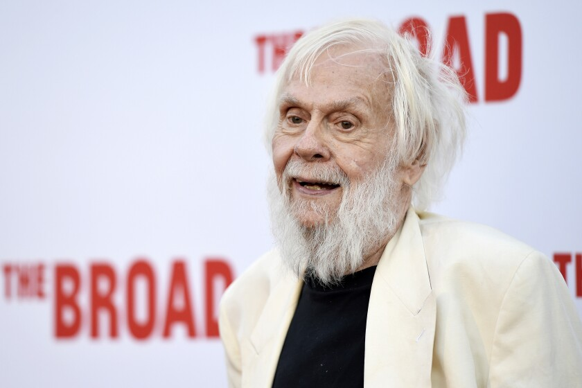 FILE - In this Thursday, Sept. 17, 2015, file photo, artist John Baldessari poses at The Broad museum's opening and inaugural dinner in Los Angeles. Baldessari, who pioneered a new genre of art in the 1970s and in the process helped elevate Los Angeles' status in the art world from that of back-water berg to a center of the conceptual movement, has died at age 88. Baldessari died Thursday at his home in Los Angeles, the artist's representatives at New York's Marian Goodman Gallery, confirmed Monday, Jan. 6, 2020. (Photo by Chris Pizzello/Invision/AP)