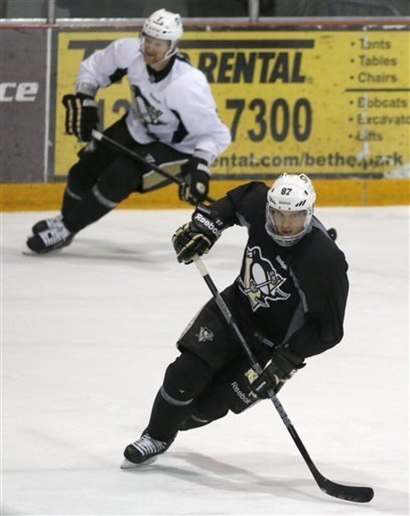 Pittsburgh Penguins' Sidney Crosby, bottom, skates with Paul Martin as they participate in an NHL hockey practice on Friday, April 26, 2013, in Canonsburg, Pa. (AP Photo/Keith Srakocic)