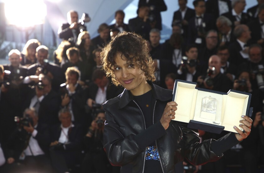 "Director Mati Diop, winner of the Grand Prix at Cannes for ""Atlantics,"" poses after the May 25 awards ceremony."